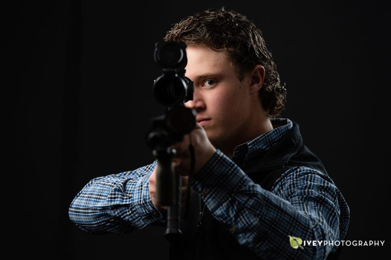 Senior portraits with an AR rifle gun